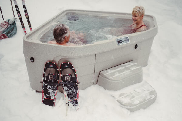 Older couple enjoying their 3-person Tristar in the snow.